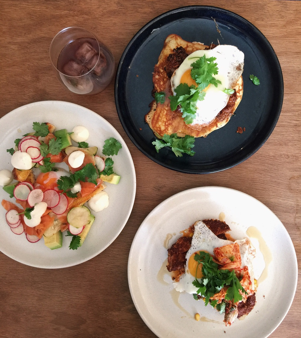 Mescal cured salmon slow egg avocado jalapeño lime toast, Cold drip coffee, Fried chicken buttermilk pancake peanuts maple butter fried egg, Pork snitzel creamed corn kimchi egg