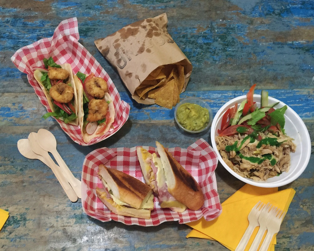 Cuban missile BBQ prawn open tortilla $13 Totally gluten free chips with fresh guacamole $7 El Presidente chicken and rice $13 Bay of Pigs traditional 'Cubano', roast pork belly sandwich $13