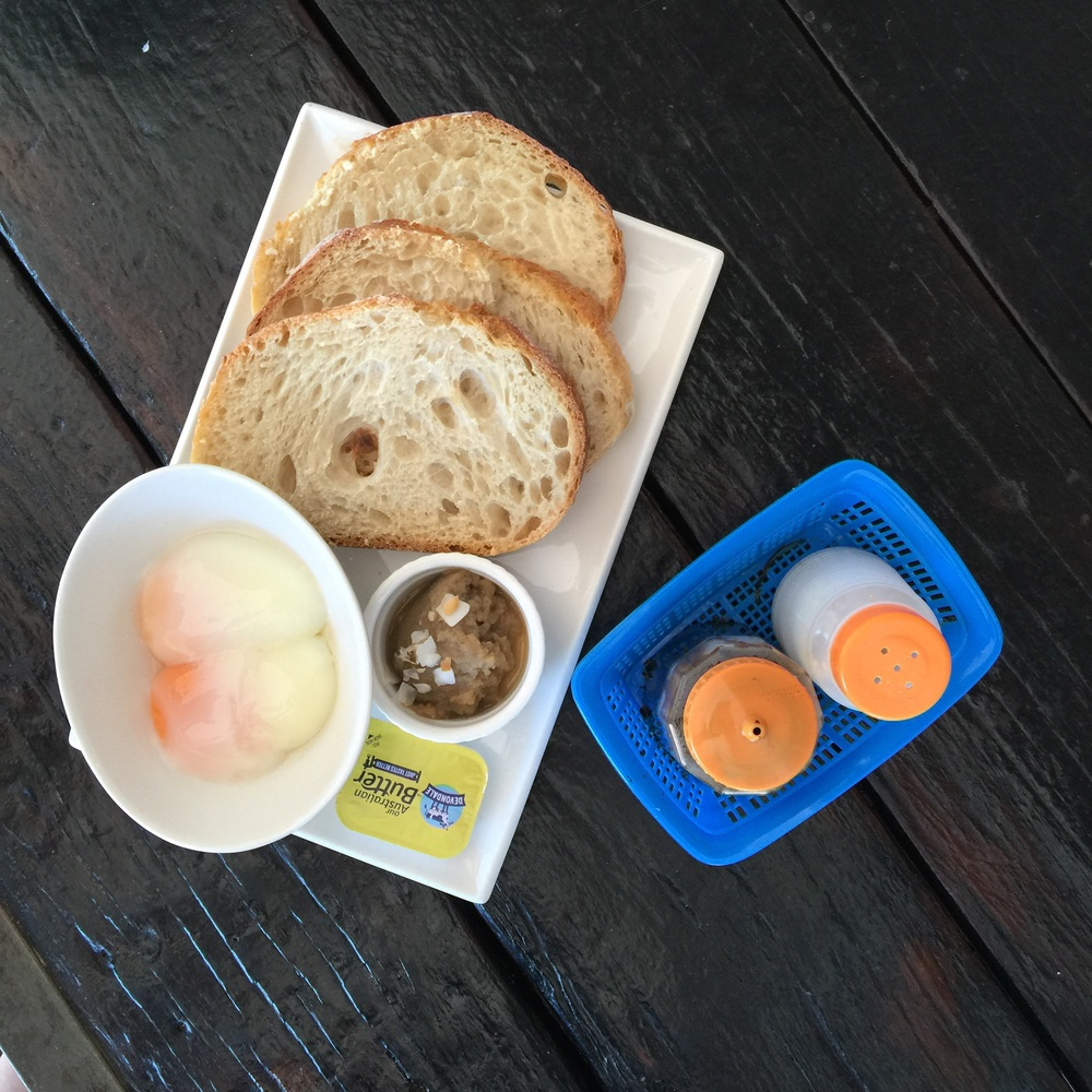Traditional Singapore breakfast - Layer Sprolo's house-made kaya jam and salted butter on the sourdough toast for a sweet and salty dance on your tastebuds.