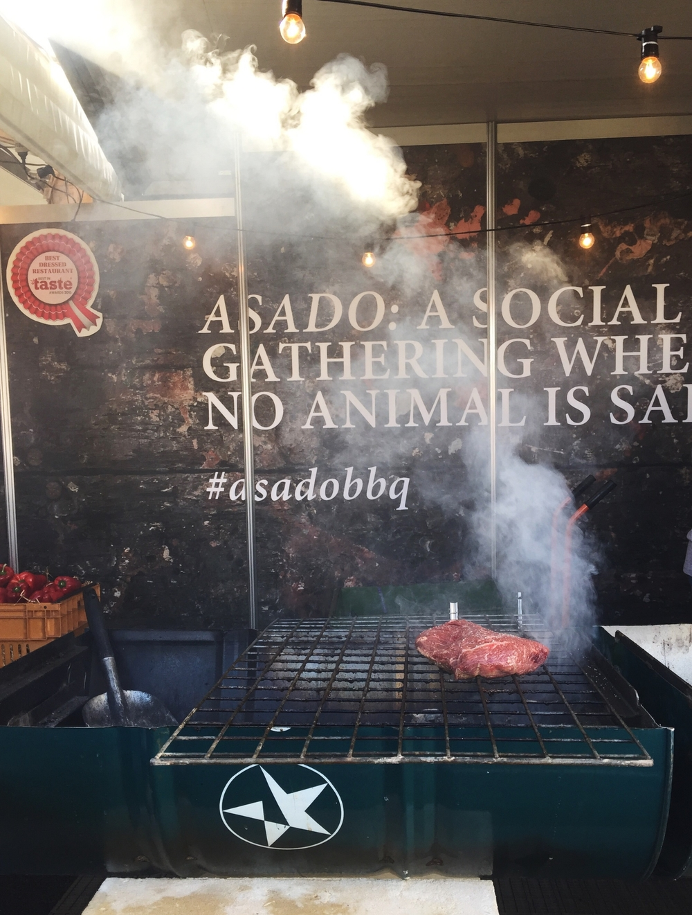'A social gathering where no animal is safe.' That's a mighty strong statement, backed up by  serious cuts of beef smoking up on the drums at  Asado  and clearly the reason why they won Best Dressed stall on Friday. Owner Rob Bates-Smith opened up the doors to Asado, a hip Argentinian restaurant with a relaxed bar, in Claremont earlier this year and its been going down a treat.