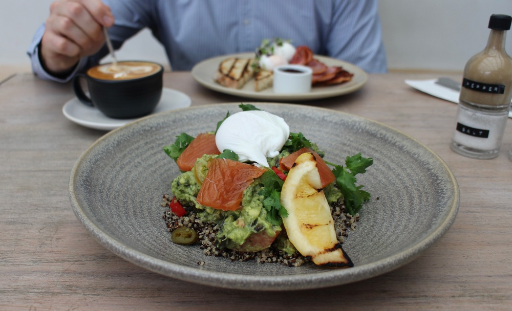 Crispy Beans and Quinoa served with chilli pickle, avocado. tomato, poached egg and cured salmon.
