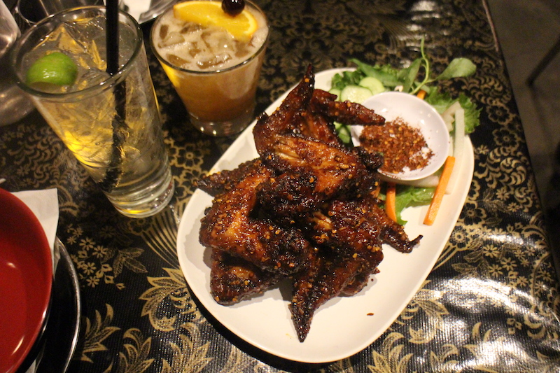 Must Order - Ike's Vietnamese Fish Sauce Wings | Half dozen fresh whole natural chicken wings marinated in fish sauce and sugar, deep fried, tossed in caramelised Vietnamese fish sauce and garlic and served with Cu Cai (pickled vegetables.)