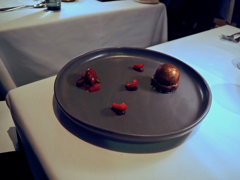 Dark chocolate sphere, chocolate cream, smoked peanut caramel, plum wine jelly, blackberry