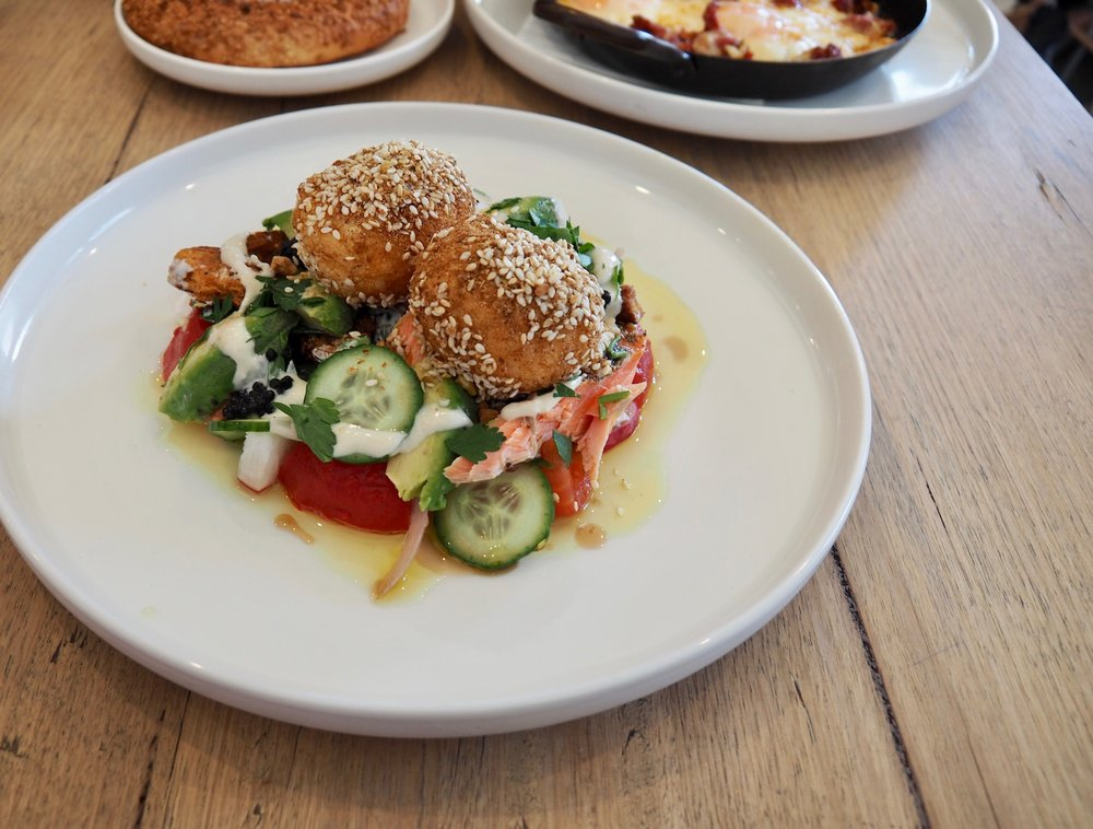 Sweet pepper & roast tomato ezme with avocado, pea, goat curd & poached eggs, zatar ocean trout