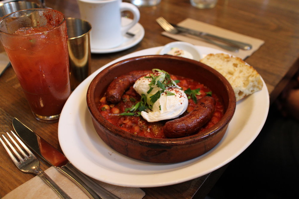 Tagine | Poached eggs, spicy merguez sausage, seasonal vegetables, stew of chickpeas, black olives and preserved lemon