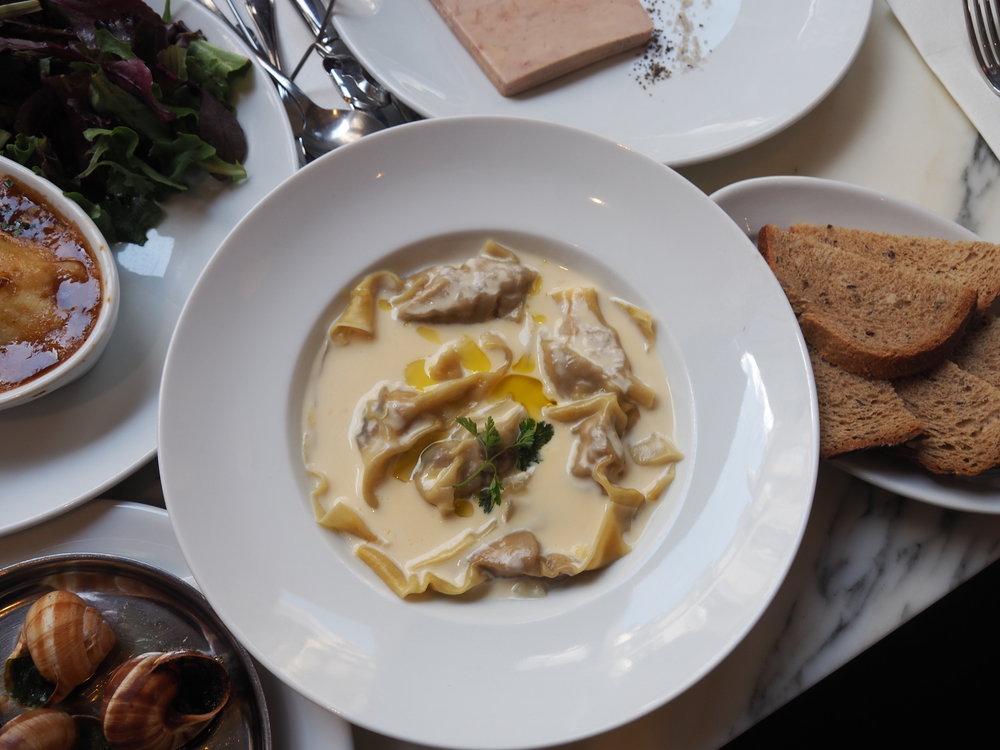 Foie gras ravioli with a truffle sauce