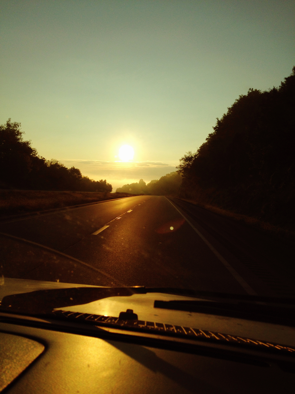 Miles of open road at sunrise.