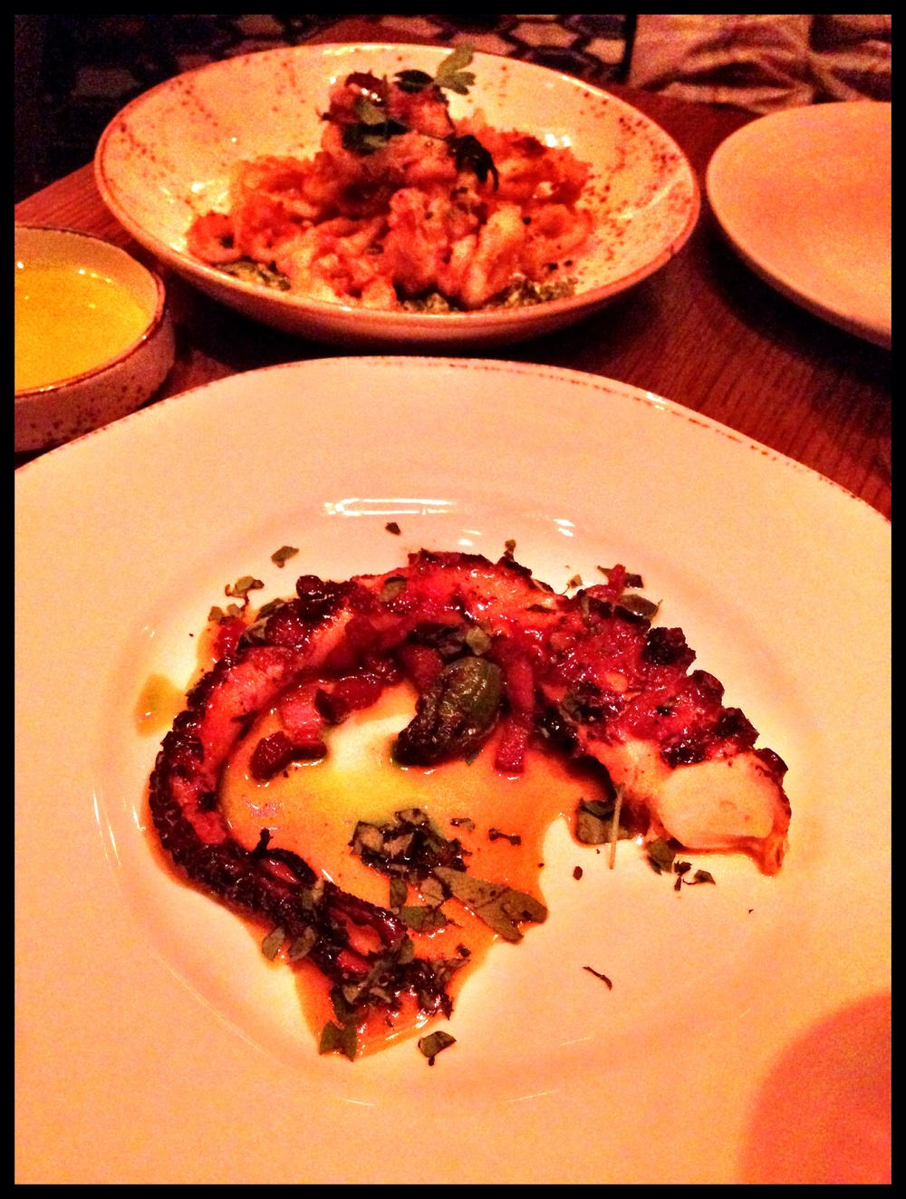 Roasted octopus - tangerine, bacon, oregano / Crispy squid in the back