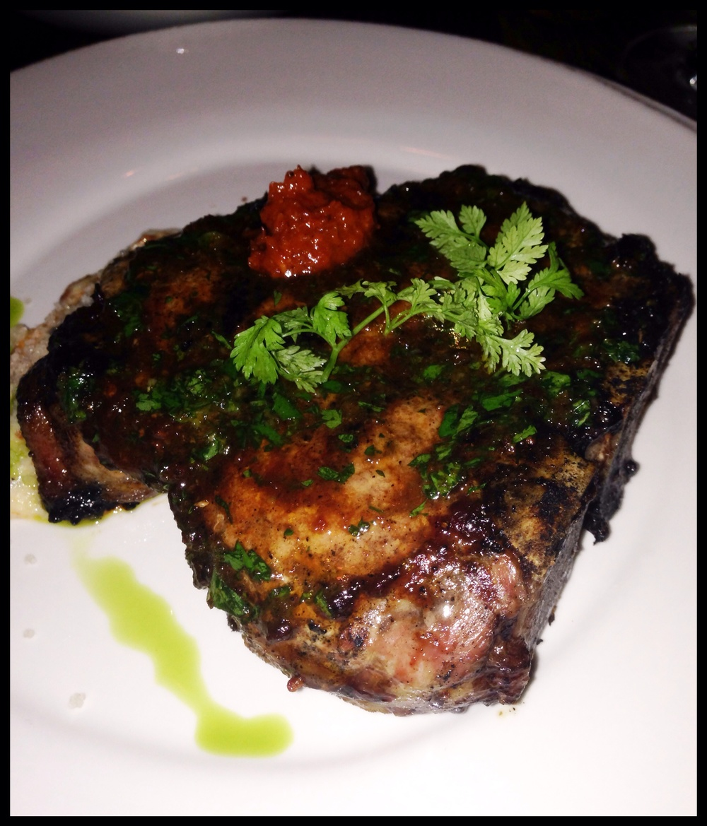 Porterhouse pork chop - tomato pan juices, romesco polenta