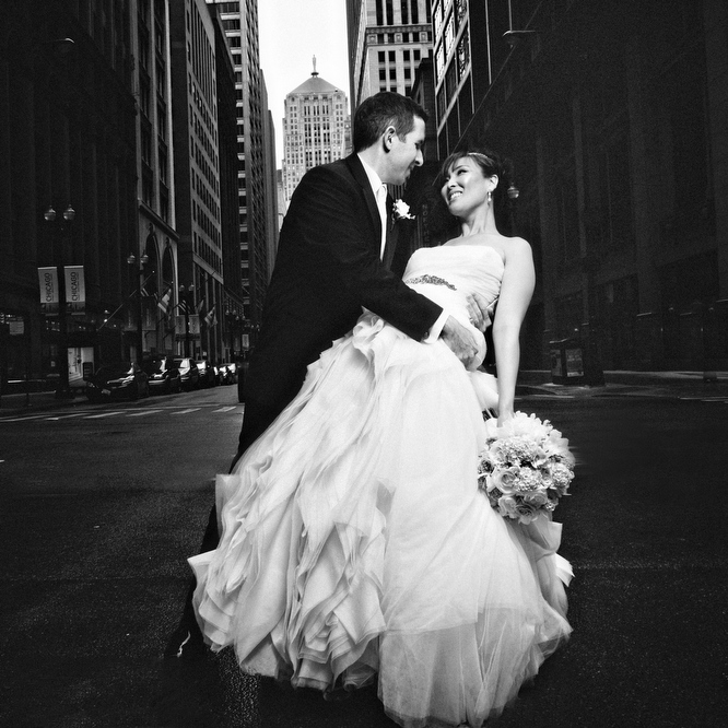 Wedding photograph at LaSalle Street/Board of Trade, Chicago, IL. May 12, 2012
