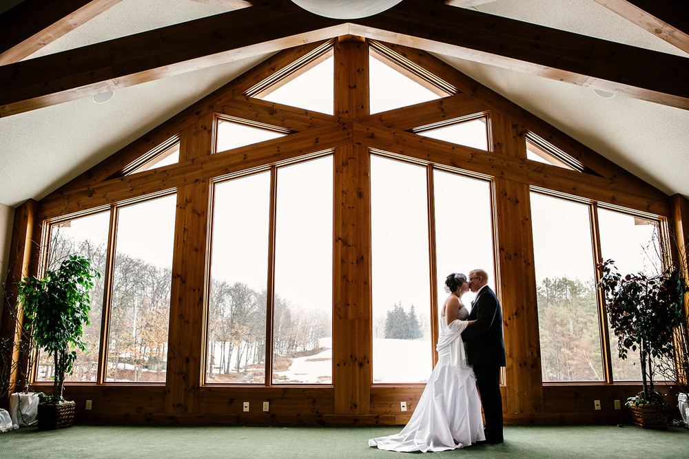 bride and groom portrait in the audobon room at cragun's resort