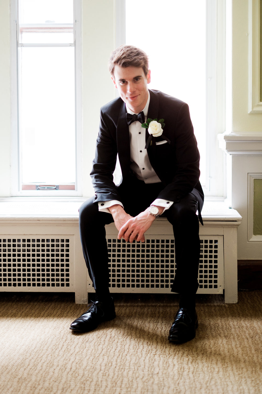 groom portrait at greysolon ballroom on his wedding day