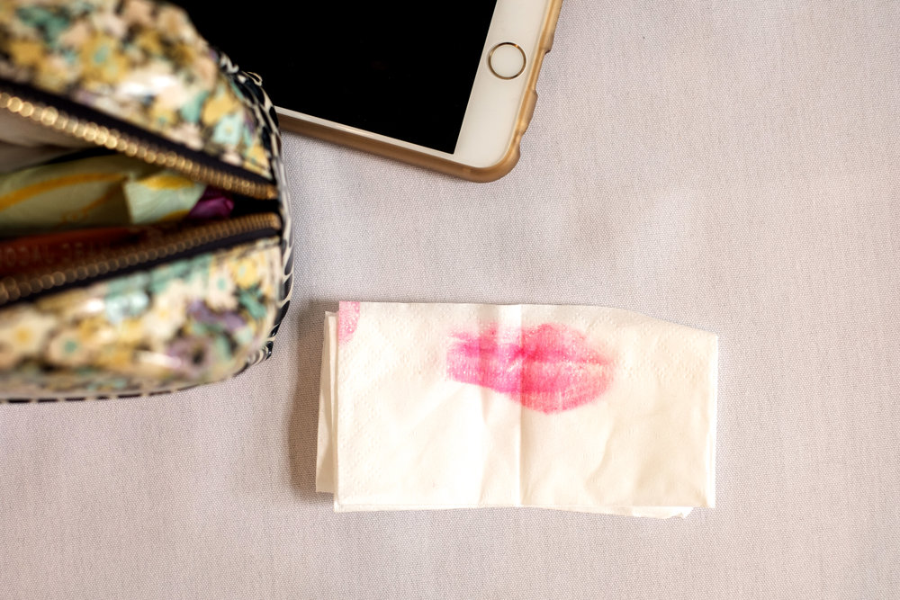 a bride blots her lip stick at Greysolong ballroom