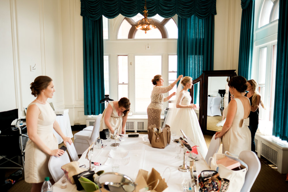 bride getting ready with her bridesmaids at greysolon ballroom