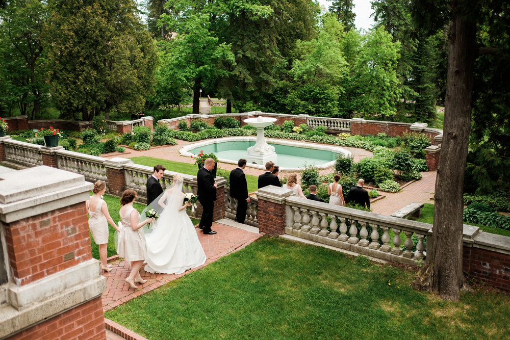 wedding party stroll through glensheen mansions grounds