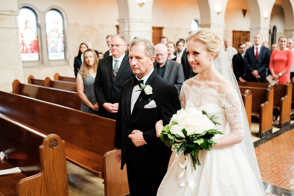 bride walking down the aisle at the duluth cathedral