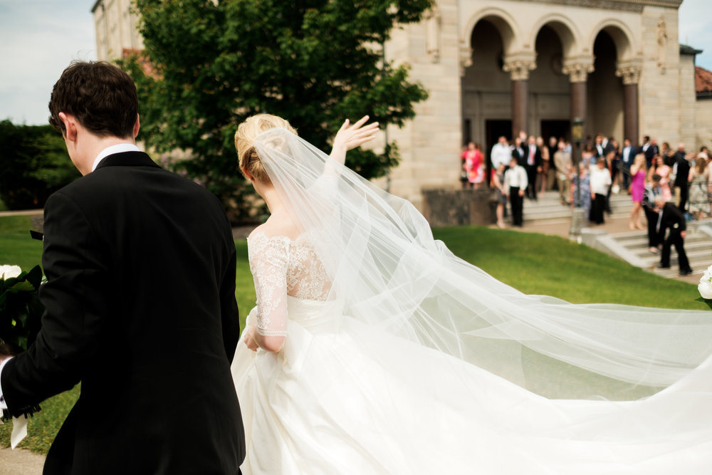couple leaving their wedding ceremony at the duluth cathedral in duluth, mn