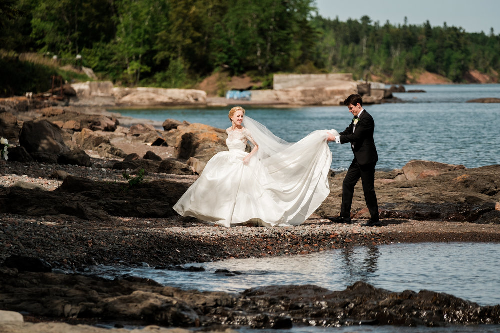bride and groom portraits on lake superior in duluth, mn