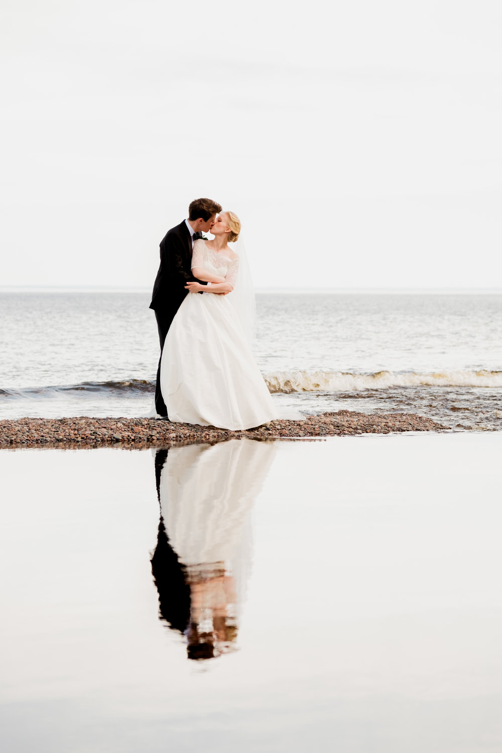 wedding portraits on the shoreline in duluth minnesota