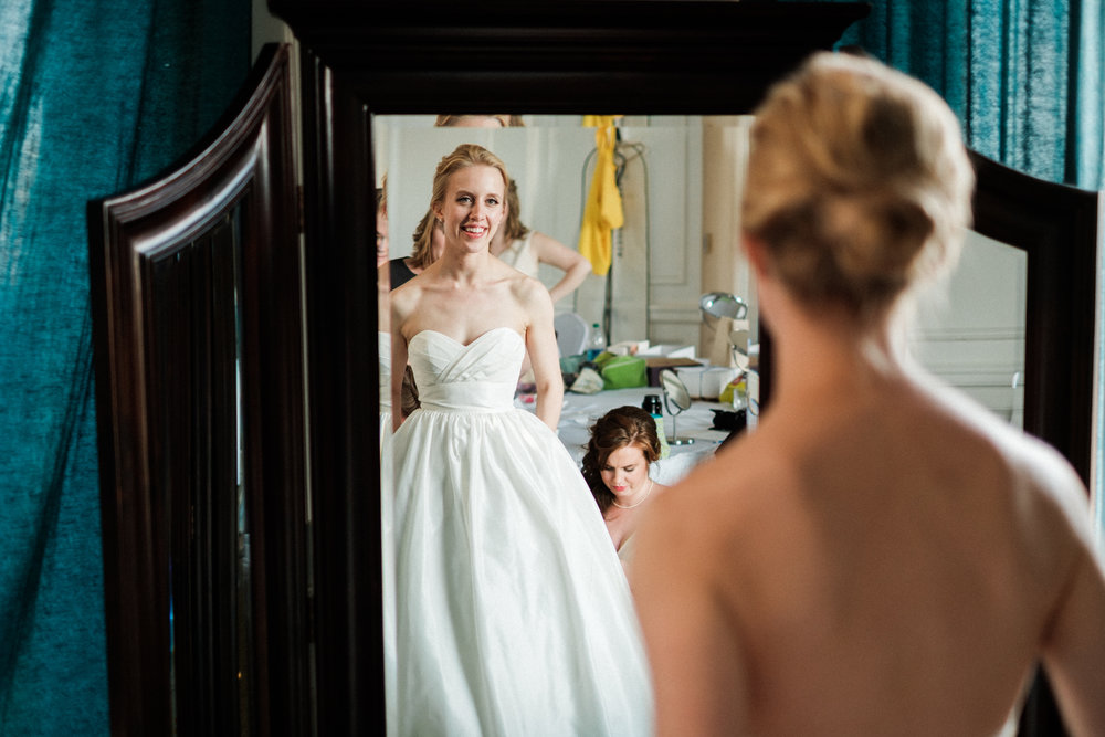 bride looking in the mirror at greysolon ballroom in duluth, mn