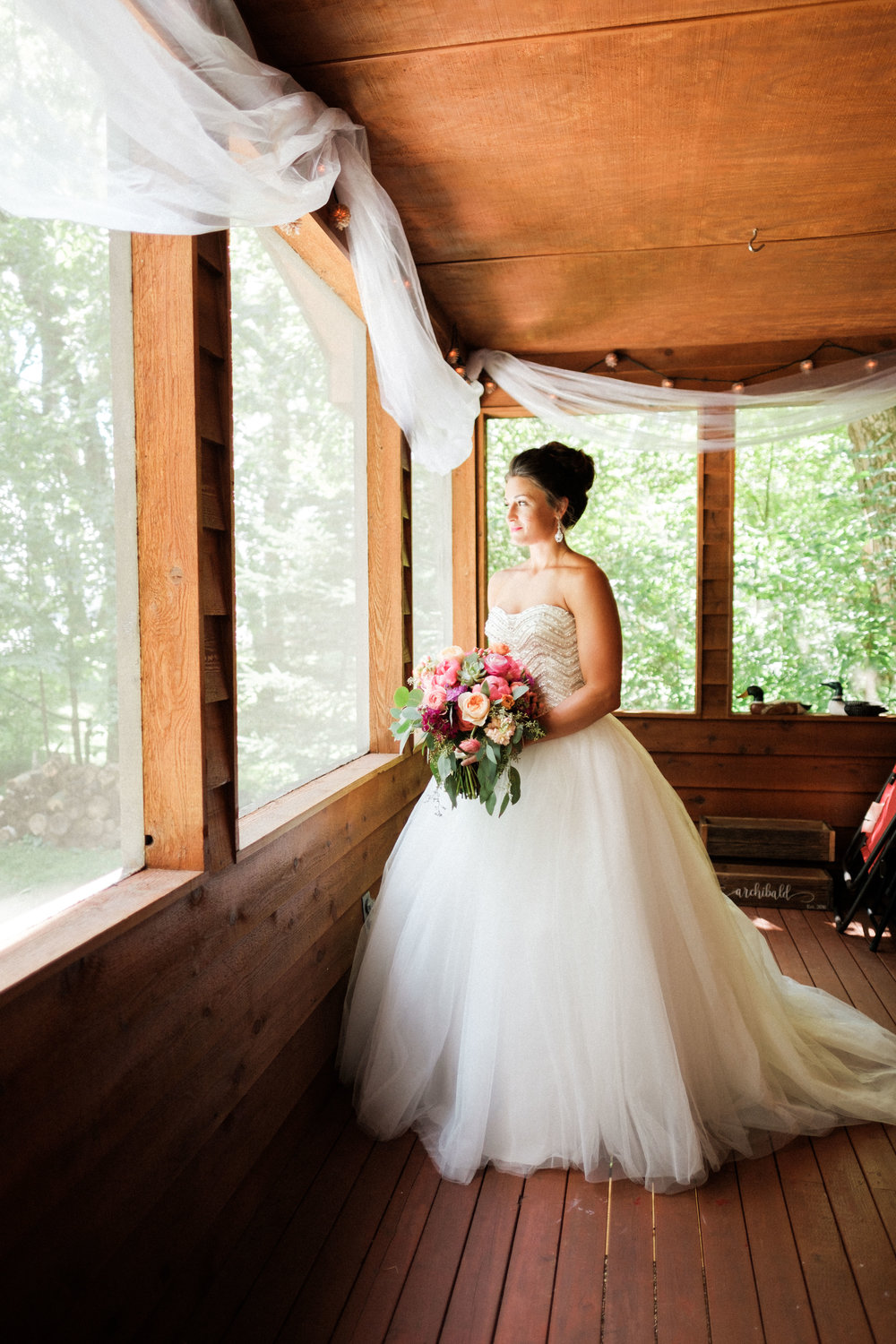 bride with her bouquet by of boom designs in Brainerd, MN