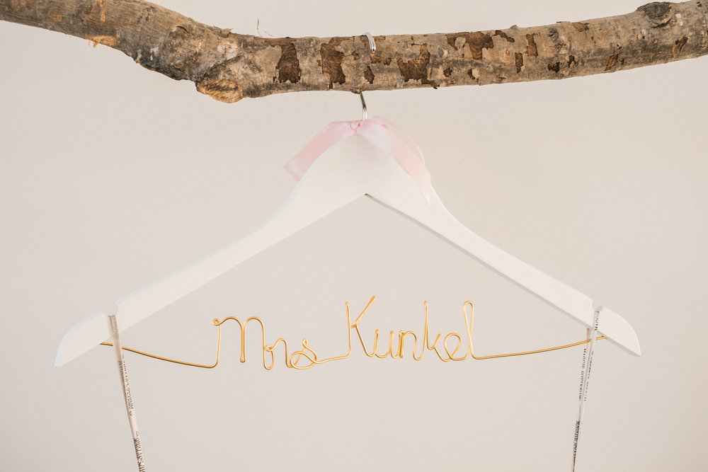 custom hanger for brides dress hanging at the NP Space in brainerd, mn