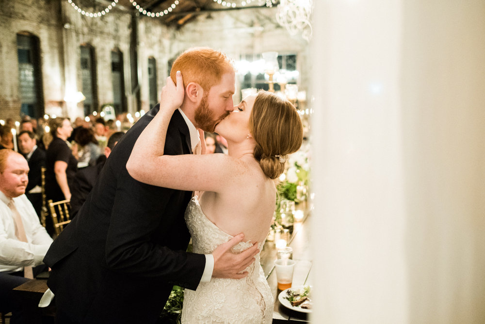 bride and groom kissing during the reception