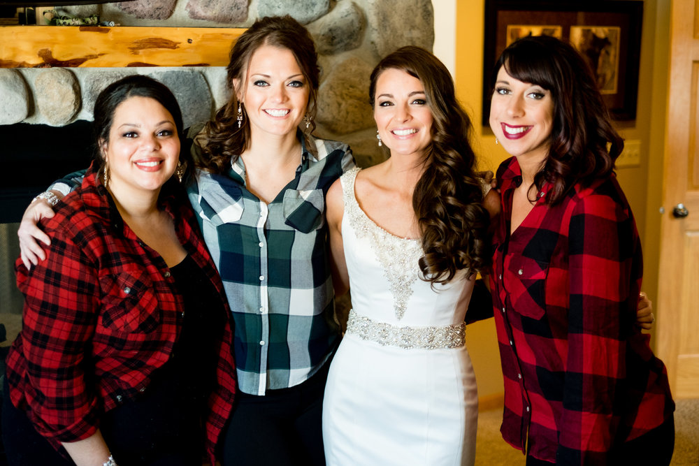 bride with her bridesmaids getting ready at pine peaks event center in crosslake