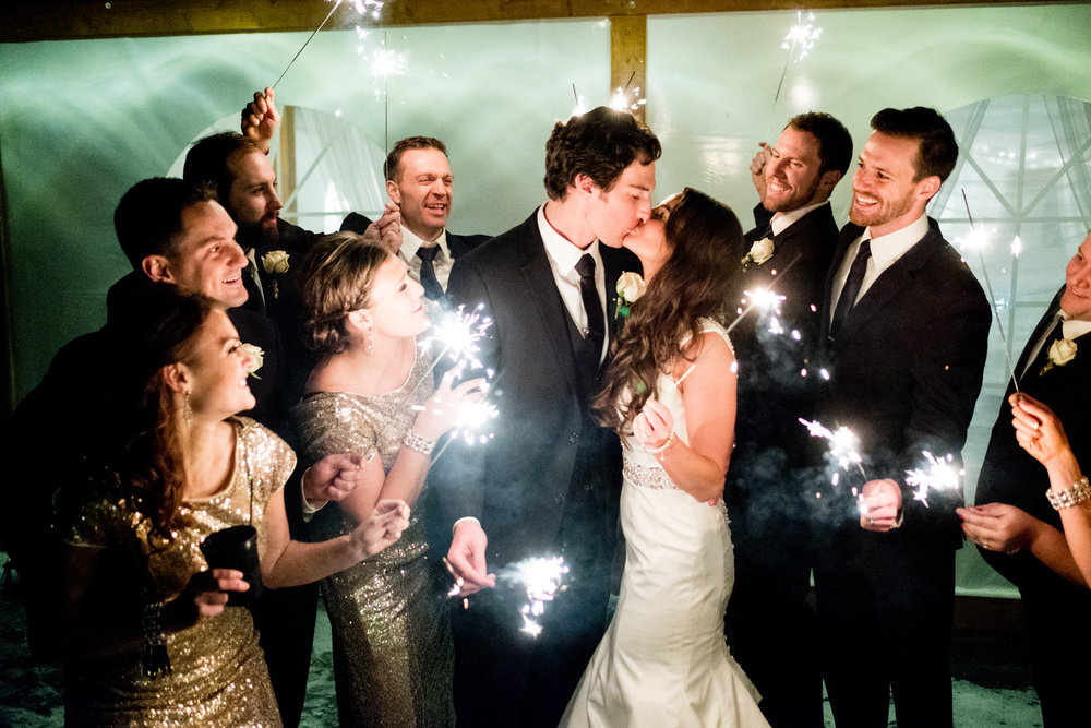 winter wedding dance at pine peaks event center in crosslake, mn sparklers