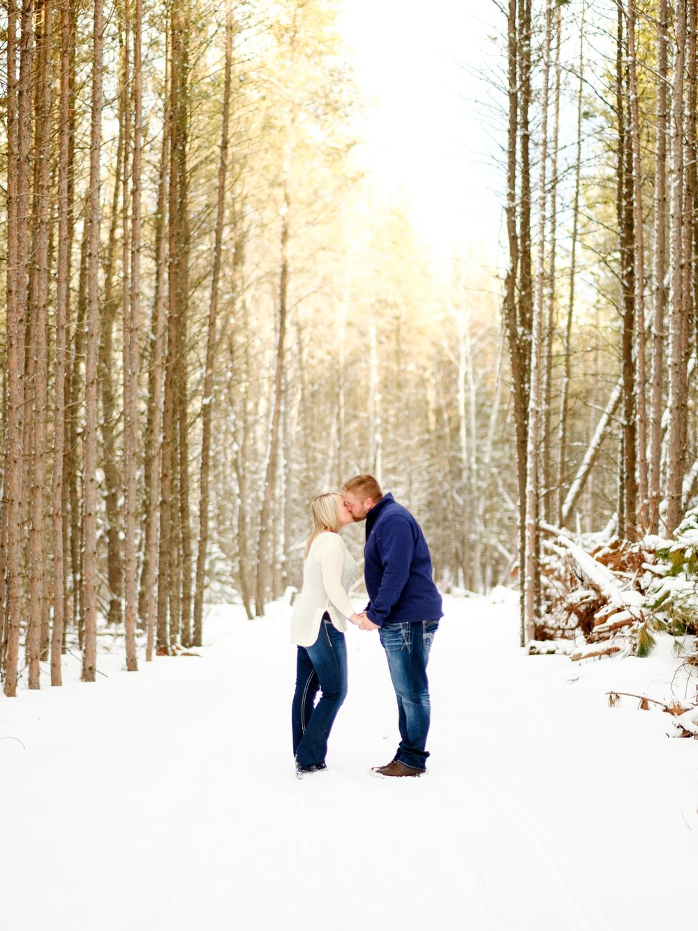 winter engagement session in the wood of northern mn