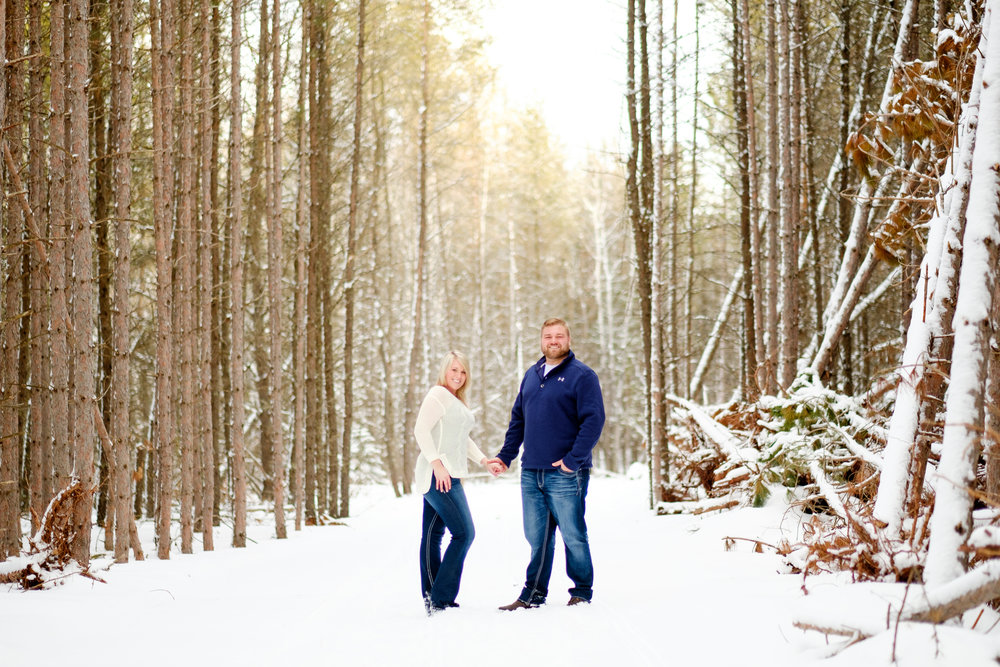 snowy winter engagement session in the wood of northern mn