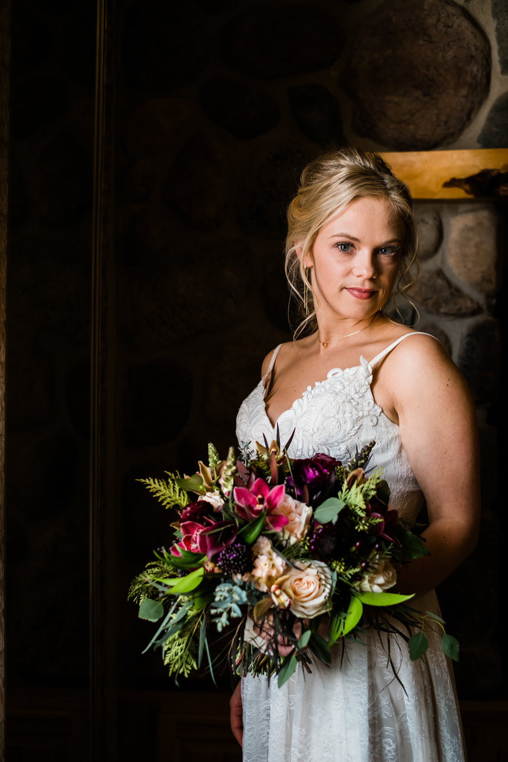 bride with her bouquet at pine peaks event center