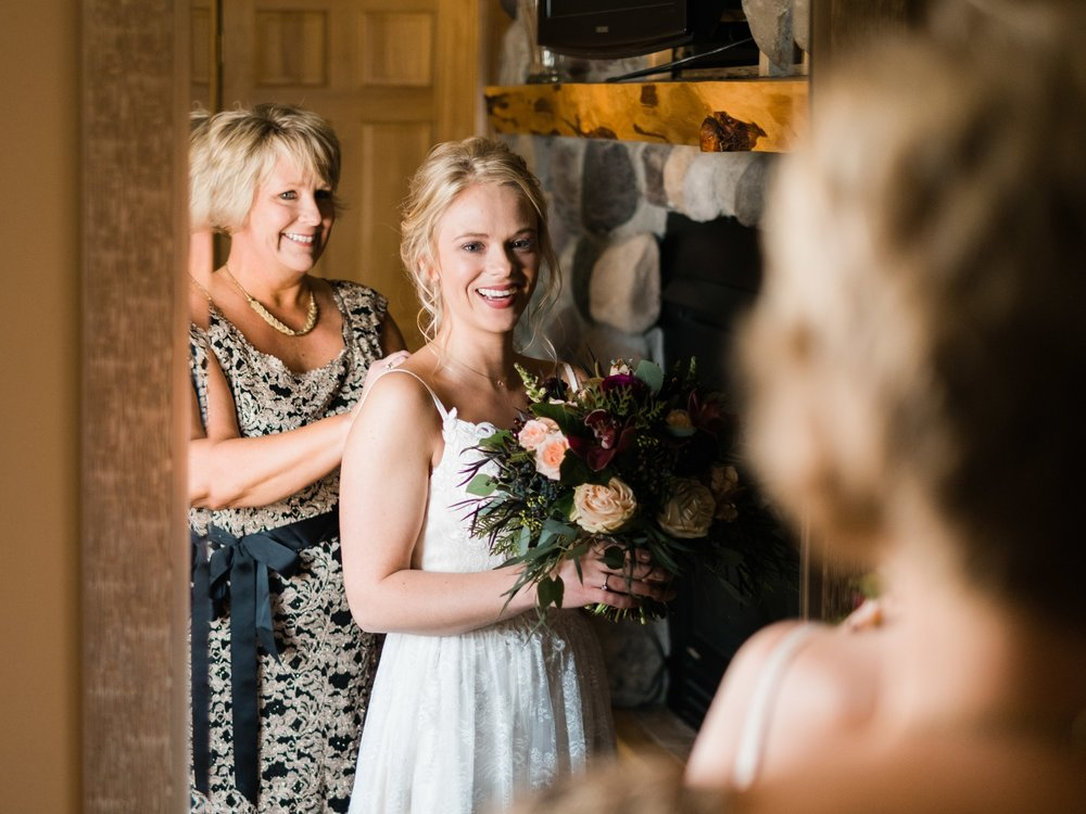bride and her mother getting ready at pine peaks event center
