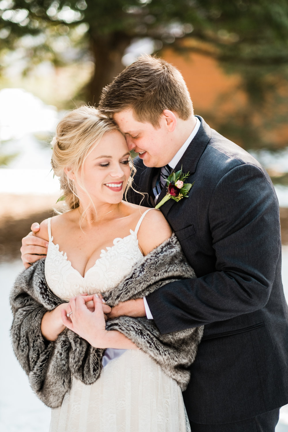 bride and groom portraits outside in winter in crosslake, mn