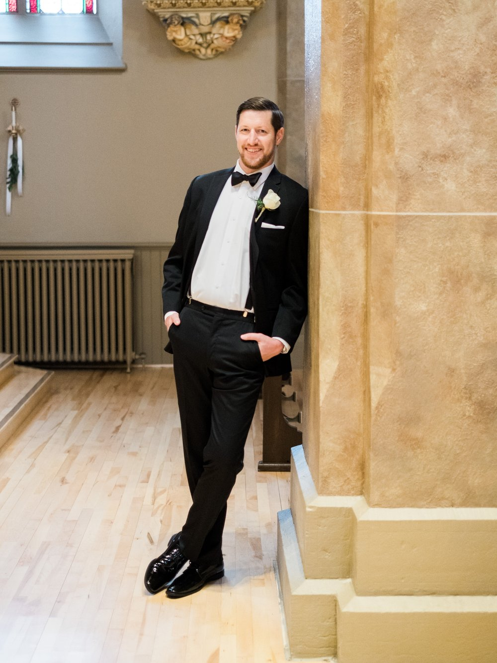 Portrait of the groom for a downtown Saint Paul wedding.