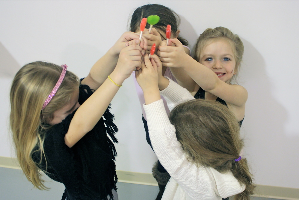 primary II students loving their heart-shaped lollies