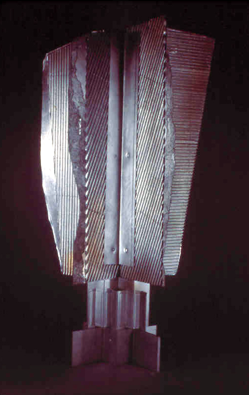 "Construction #7, corrugated head   cardboard, corrugated board, aluminum spray paint   36"" x 24"" x8""  5/18/1985  collection of the artist"