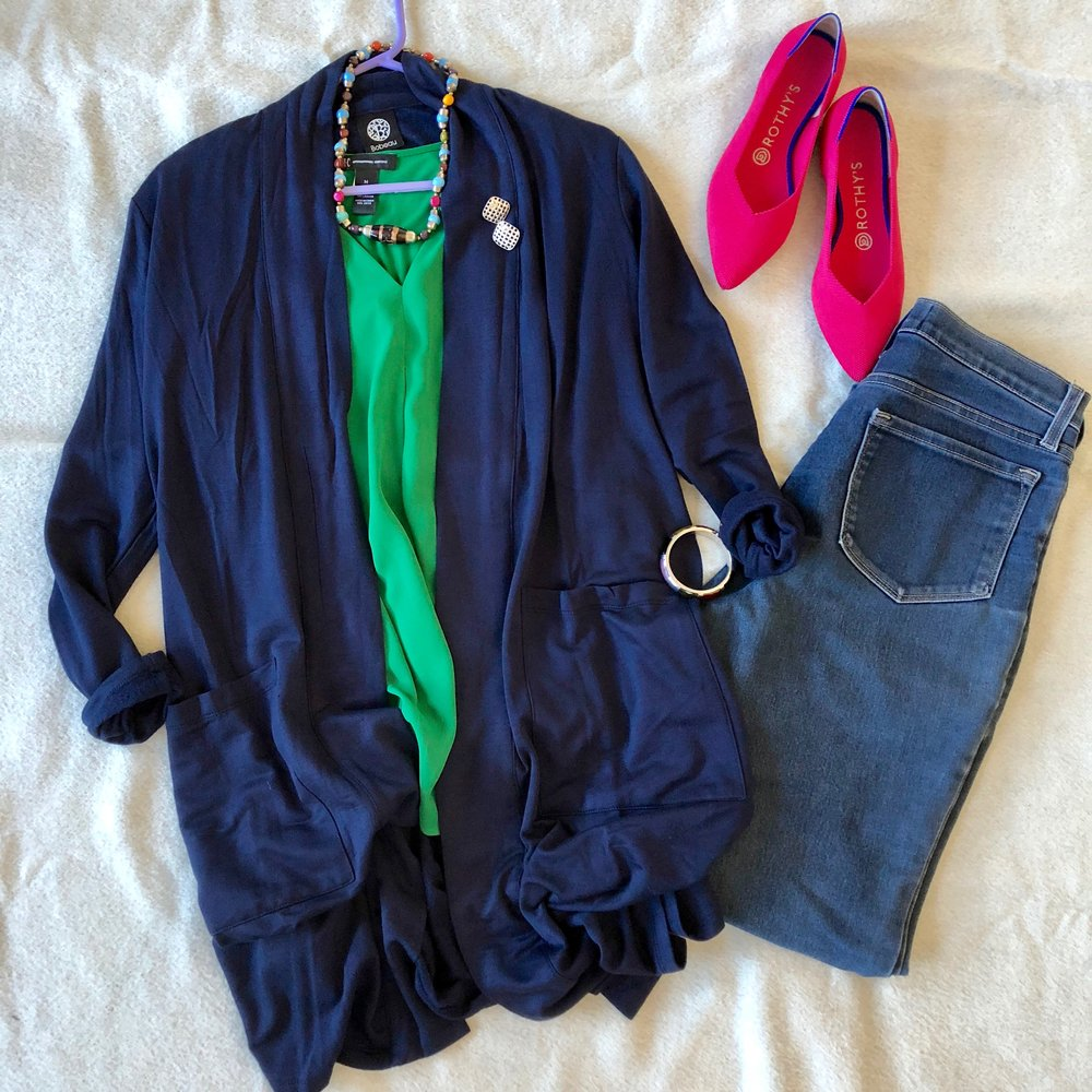 Play with warm and cool shades together with a green top, navy cardigan and pink flats - and multicolored jewelry amplifies the palette.