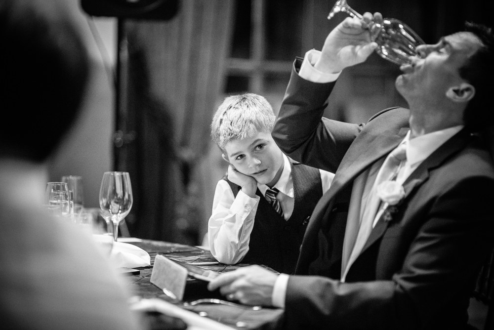 Small child looking bored at wedding reception