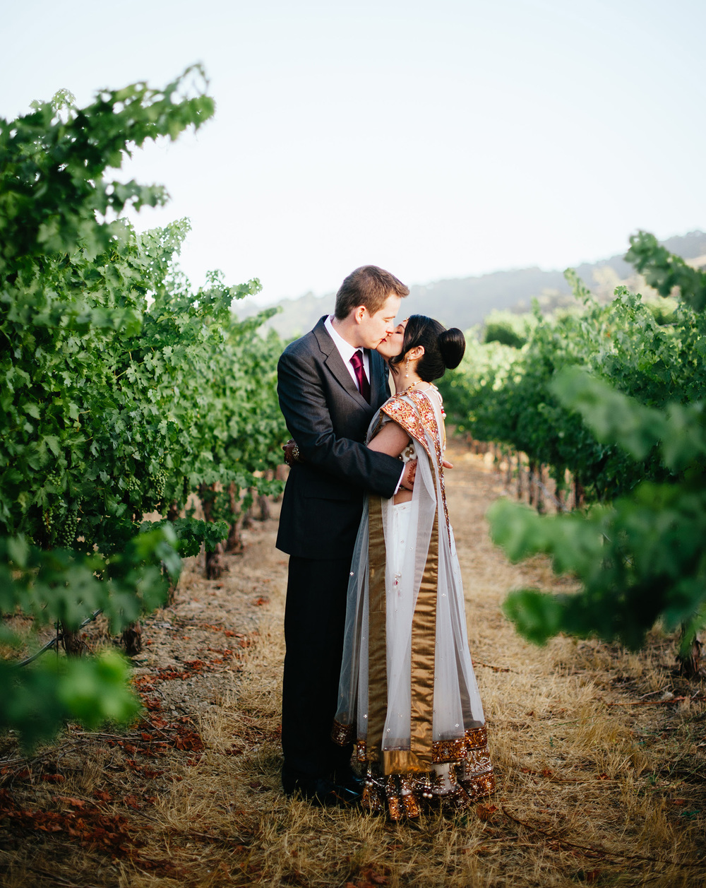 Indian bride and groom kissing portrait at Clos LaChance Winery