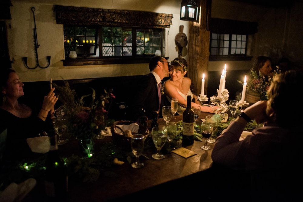 Bride and groom embracing in candlelight at Pelican Inn Muir Beach