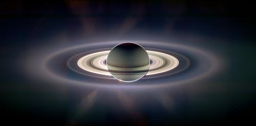 Cassini created this panoramic view of the Saturn system, with Earth appearing as a pale blue dot, in 2006.