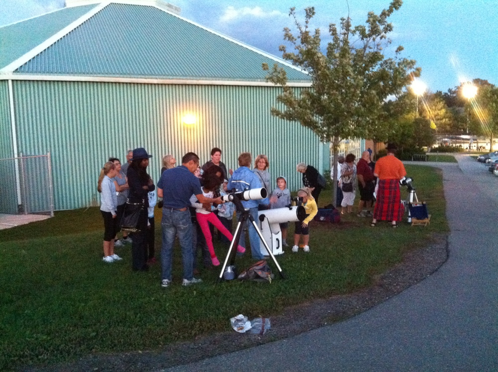 Visitors to the South Common Library look through telescopes at the Moon on September 12, 2013