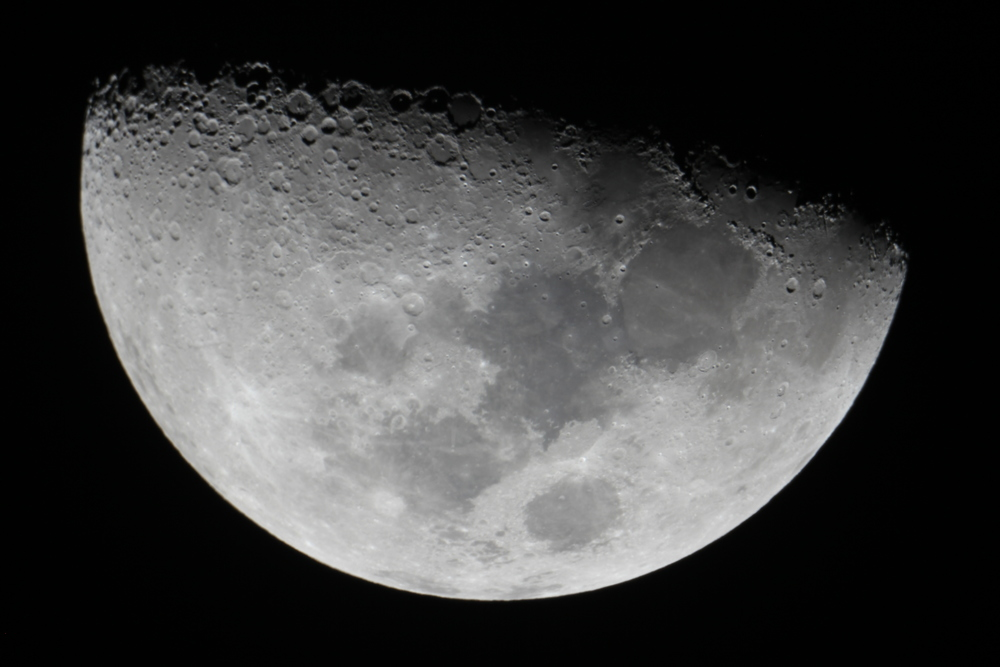 The Moon will look like this through our telescopes - a half-Moon.