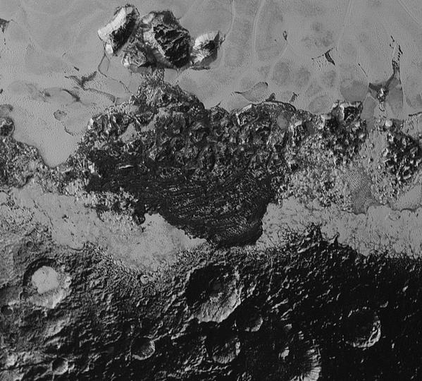 This 220-mile (350-kilometer) wide view of Pluto from NASA's New Horizons spacecraft illustrates the incredible diversity of surface reflectivities and geological landforms on the dwarf planet. The image includes dark, ancient heavily cratered terrain; bright, smooth geologically young terrain; assembled masses of mountains; and an enigmatic field of dark, aligned ridges that resemble dunes; its origin is under debate. The smallest visible features are 0.5 miles (0.8 kilometers) in size. This image was taken as New Horizons flew past Pluto on July 14, 2015, from a distance of 50,000 miles (80,000 kilometers).
