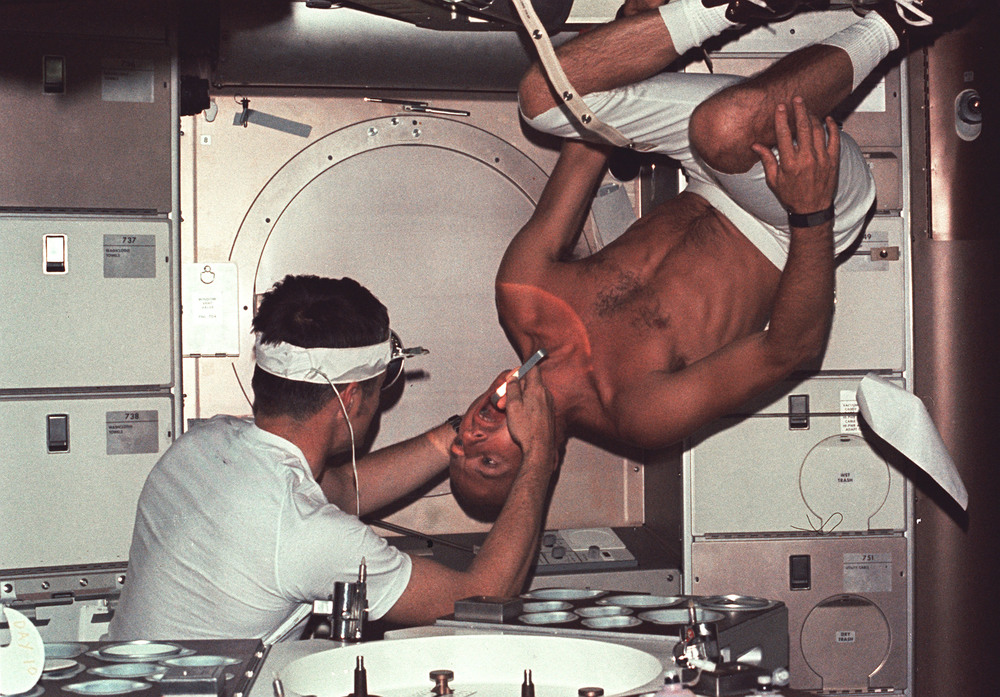 Dr Joe Kerwin examines fellow astronaut Pete Conrad on Skylab in 1973.