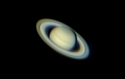 The rings of Saturn are visible when viewed through a telescope.