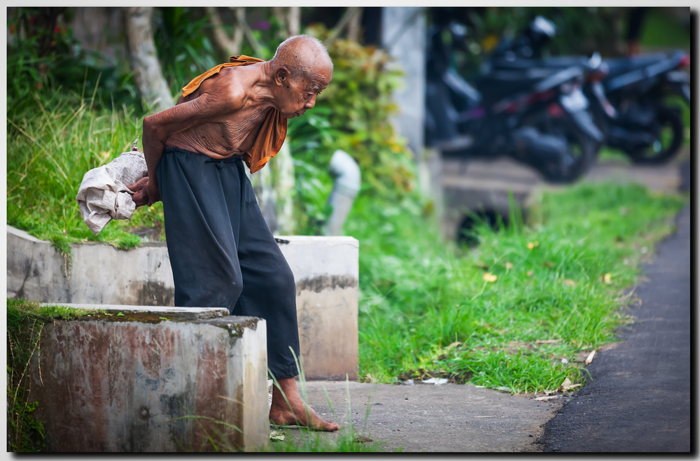 Generations older, in the same family home - a Balinese man over 100 years old.