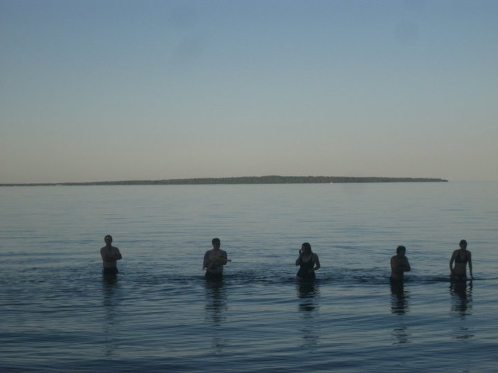 With friends swimming in Lake Superior.