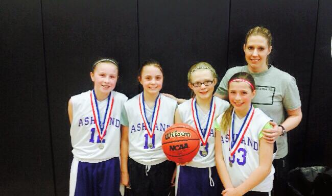 Steph with her daughter Haillee and fellow members of the basketball team she coaches.